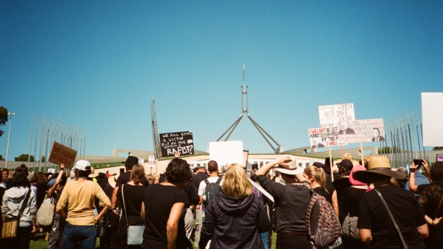 Picture of protest signs in front of Australian Parliament House at the March 4 Justice