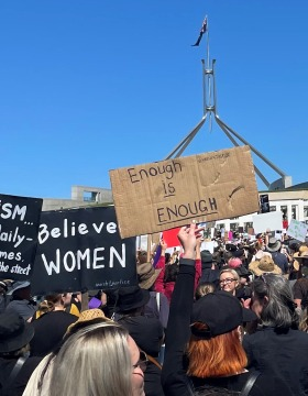 Protest signs at the march 4 justtice outside parliament house
